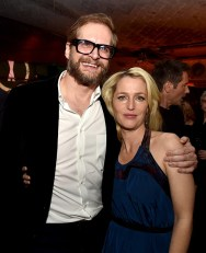 "LOS ANGELES, CA - JANUARY 12: Writer Bryan Fuller (L) and actress Gillian Anderson pose at the after party for the premiere of Fox's ""The X-Files"" at the California Science Center on January 12, 2016 in Los Angeles, California. (Photo by Kevin Winter/Getty Images)"